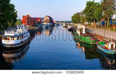 Danes river with Klaipeda central wharf and cruise terminal. Klaipeda town, Lithuania.
