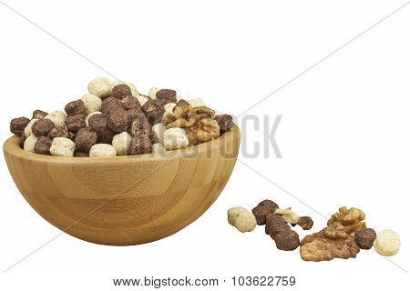 Chocolate cereal balls in a bowl of bamboo. Healthy breakfast with fruit and milk. A diet full of en