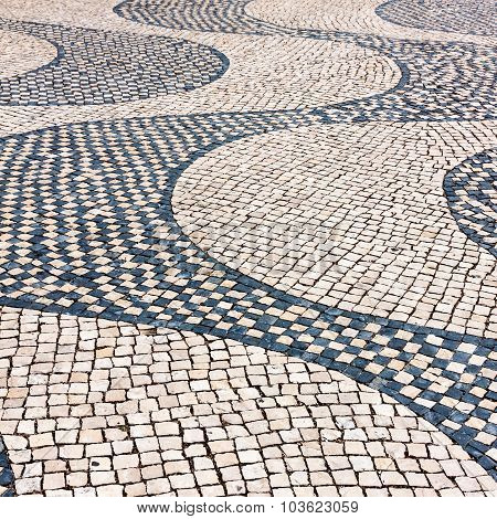 Typical Cobblestone Hand-made Pavement Iin Lisbon, Portugal