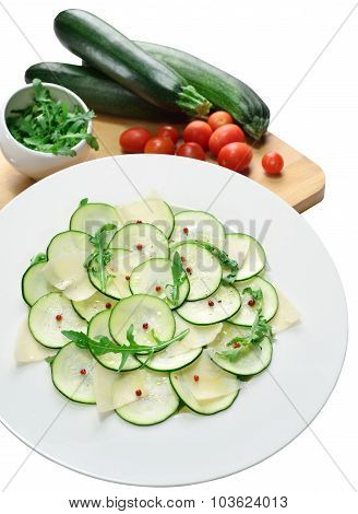 Salad Of Zucchini With Cheese And Arugula On Isolated Background