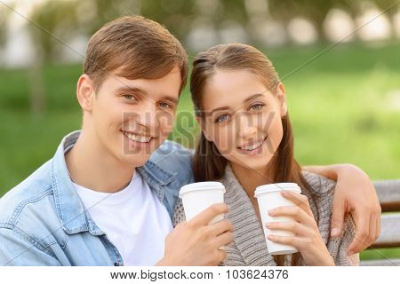 Positive couple drinking coffee
