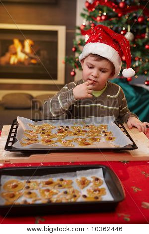Young Boy Tasting Christmas Cake