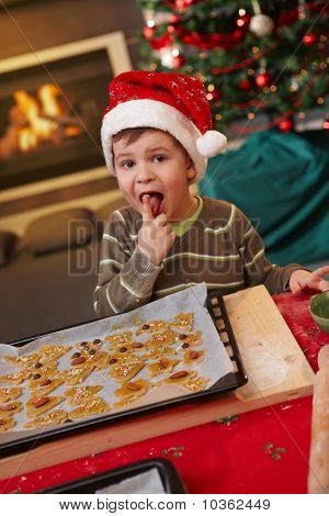 Small Boy Tasting Christmas Cake