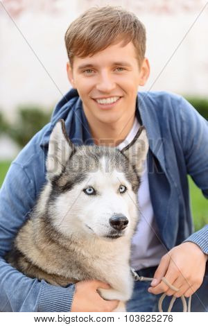 Positive guy sitting with dog