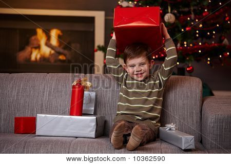 Little Boy Holding Christmas Present