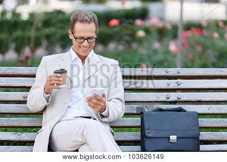 Handsome man drinking coffee