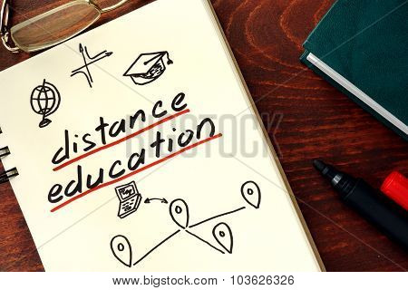 distance education written in the notepad.