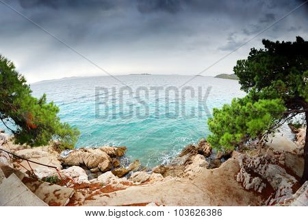 Stairs To The Beach, Clear Water And Cloudy Sky In Croatia Dalmatia