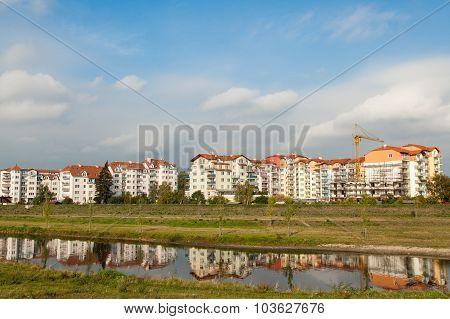 Multistorey Buildings Reflected In River