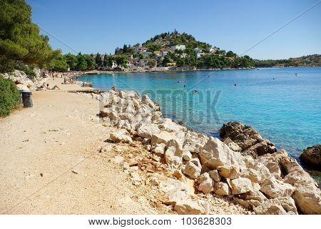 Rocky And Concrete Beach In The Bay Turquoise Sea, Croatia Dalmatia