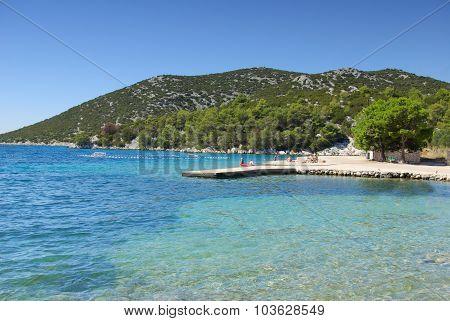 Concrete Empty Beach In The Bay Of Turquoise Sea, Croatia