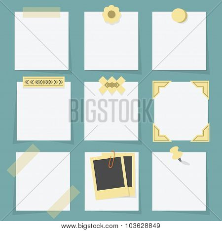 Small little attached blank paper notes on teal background
