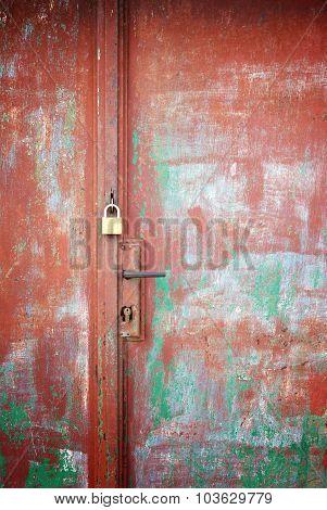 Padlock And Handle On Rusty Door, Detail