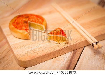 Moon Cake,chinese Mid Autumn Festival Dessert. On Wooden Table