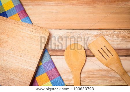 Fork, Knife And Table Cloth On Wooden Background. Top View With Text Space