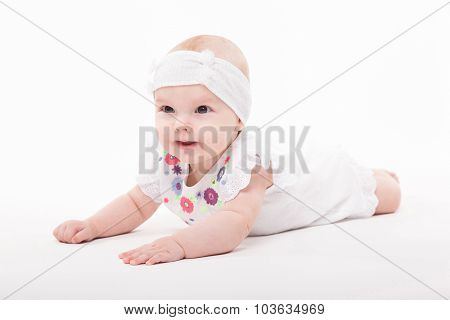 Baby Girl On A White Background In A Smart Dress