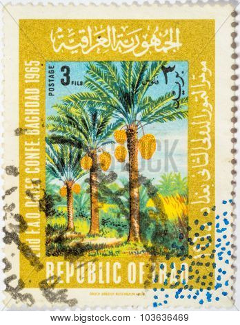 Moscow, Russia - October 3, 2015: A Stamp Printed In Iraq Shows Palm Trees, Dedicatet To The 2Nd F.a