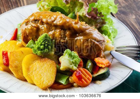 Pork Rolls With Prepared Potatoes And Vegetables