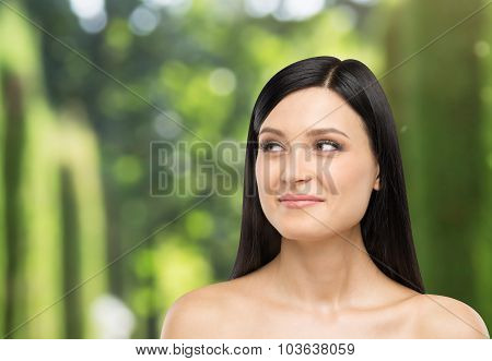A Portrait Of A Smiling Brunette Lady Who Is Looking At Something On The Right Side. Tropical Landsc