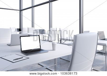 Workplaces In A Modern Corner Panoramic Office, Copy Space In The Windows. Open Space. White Tables