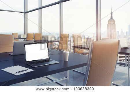 Workplaces In A Modern Corner Panoramic Office In New York. Black Tables And Brown Leather Chairs. A