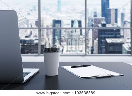 A Workplace In A Modern Panoramic Office In Manhattan, New York City. A Laptop, Notepad And A Coffee