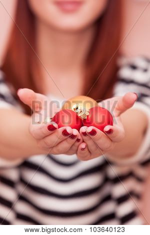 Girl Showing Christmas Baubles