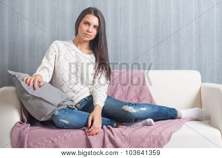 Relaxing On Couch, Sofa   At Home, Comfort. Cute Young Woman Smiling,