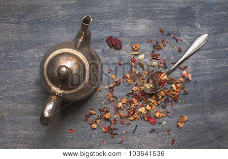 Antique Teapot And Strawberry Tea On Dark Wooden Background