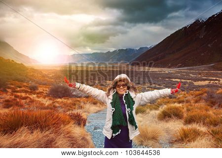 Woman Traveler Wearing Winter Clothes Take A Photo With Happiness Emotion In Sun Rise Natural Mounta