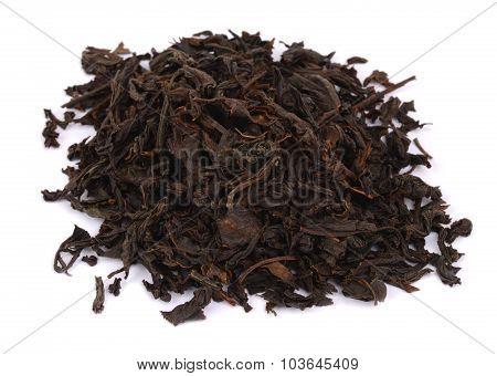 dry black tea leaves isolated on white