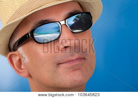 Close up of a man's face wearing sunshades