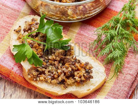 sandwich from mushroom caviar decorated with greens