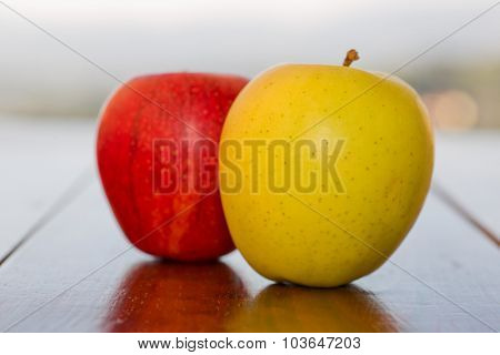 Apples on wooden table outdoor