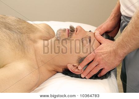 Man Massaging Male Face