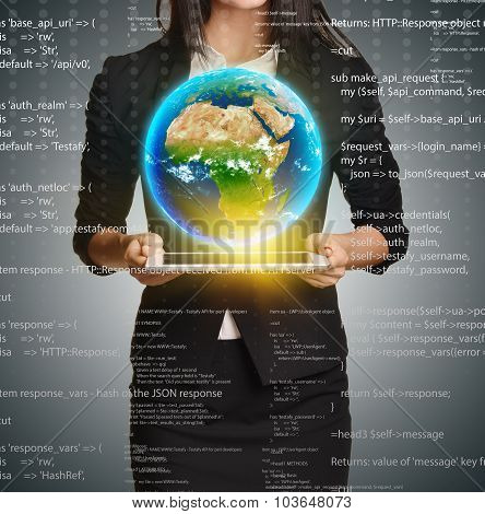 Woman in a suit holding tablet palms and Earth upon him