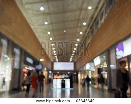 Blurred shopping mall background, shallow depth of focus.