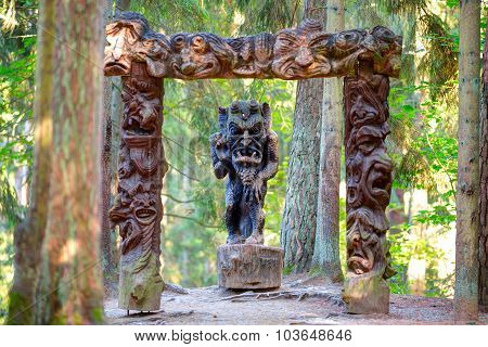 Old wooden sculptures in the forest.