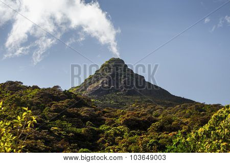 The mountain of Adam's Peak (local name is Sri Pada, 2243m (7359ft)) with the cloud looking like volcano smoke.