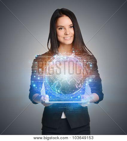 Smiling Girl holding digital globe over tablet