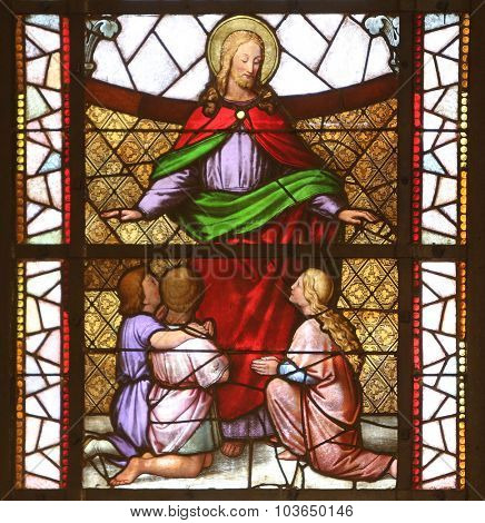 ZAGREB, CROATIA - NOVEMBER 08: Jesus friend of children stained glass window in the Church of St. Vincent de Paul in Zagreb, Croatia on November 08, 2014