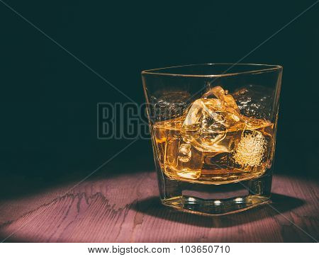 Top Of View Of Glass Of Whiskey With Ice Cubes On Wood Table, Warm Atmosphere, Time Of Relax With Wh