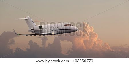 Private jet flying over a sunset sky
