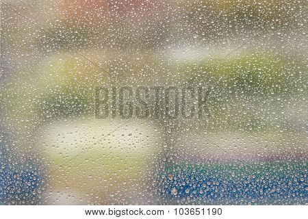 Water Drops flowing glass closeup. Rainy weather