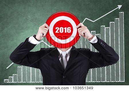 Entrepreneur Holds Dartboard With Numbers 2016