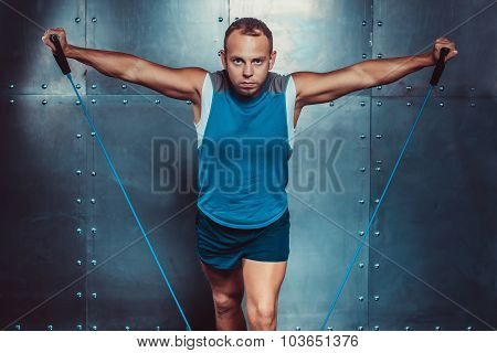 Sportsmen. Fit Male Trainer Man Doing Exercises With Expanders, ConceptFitness Workout Str