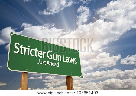 Stricter Gun Laws Green Road Sign With Dramatic Clouds and Sky.
