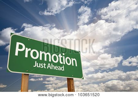 Promotion Green Road Sign With Dramatic Clouds and Sky.