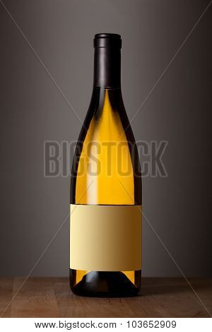 Bottle of white wine with a blank label