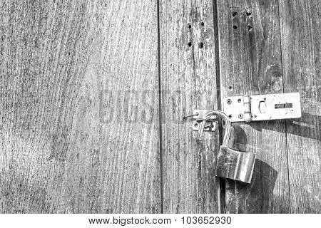 Black And White Photography Of Brass Pad Lock On The Wooden Door